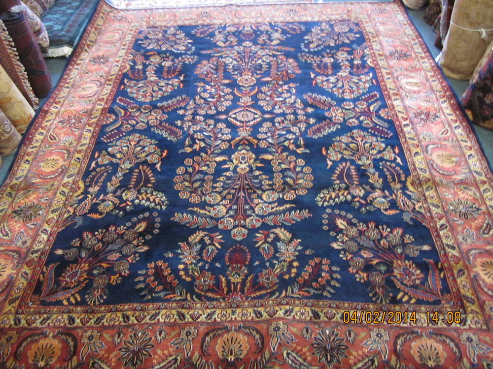 "#11) 8'7"" x 11' Navy Sarouk rug. Woven in India."