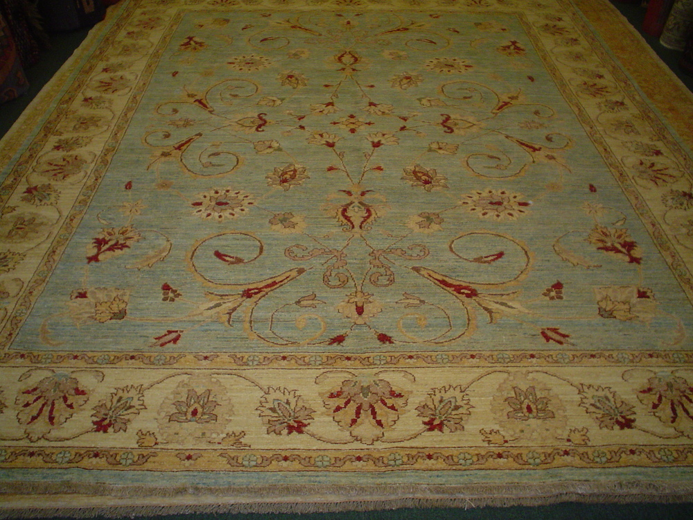 #6) 8 x 10 light blue Afghan rug in an overall Herati design.