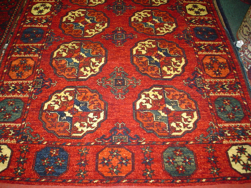 #8) 4 x 6 Turkoman rug. New rug in a traditional Turkoman design.