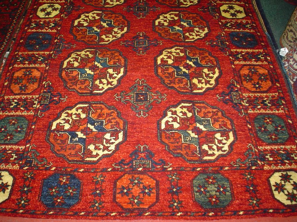 #8) 4 x 6 Turkoman rug. New rug in a traditional Turkoman design.