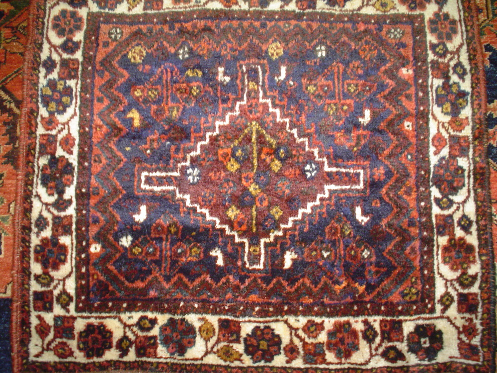 "#9) 2'7"" x 2'10 semi-antique Persian bagface. (front of an old saddle bag) Shiraz, Iran. Silky wool, warm earth tones."