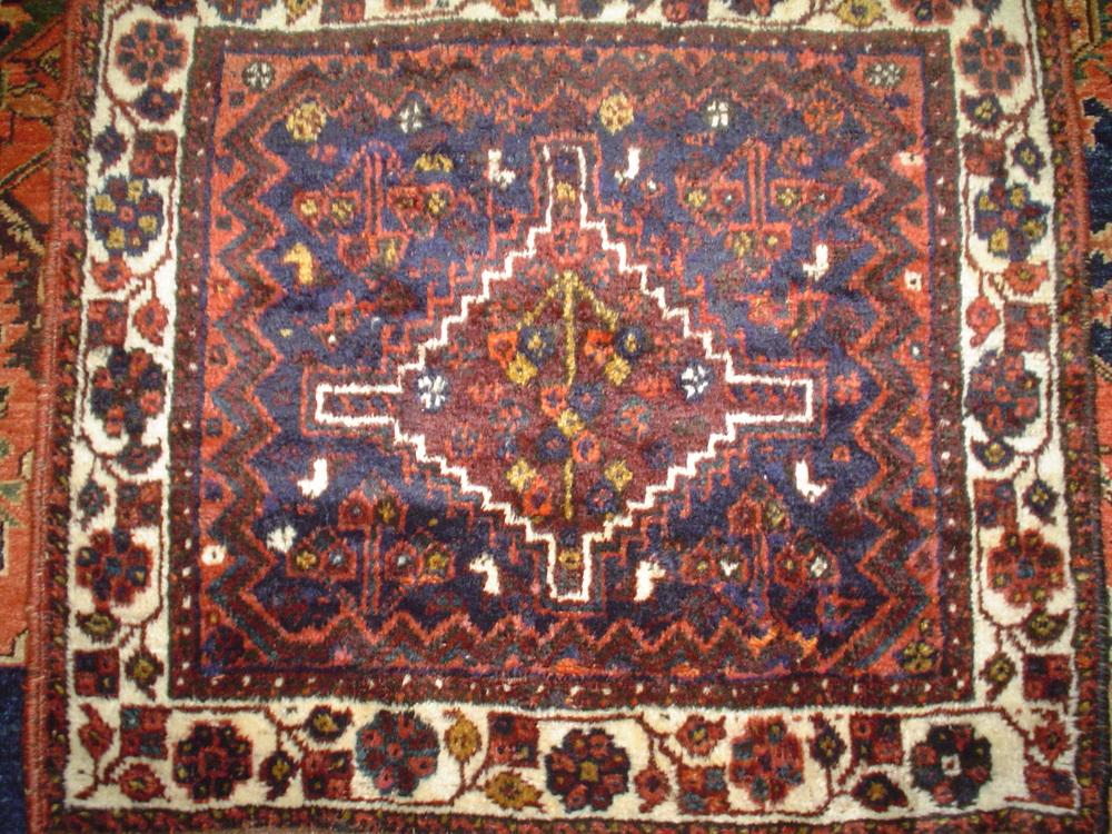 "#8) 2'7"" x 2'10 semi-antique Persian bagface. (front of an old saddle bag) Shiraz, Iran. Silky wool, warm earth tones."