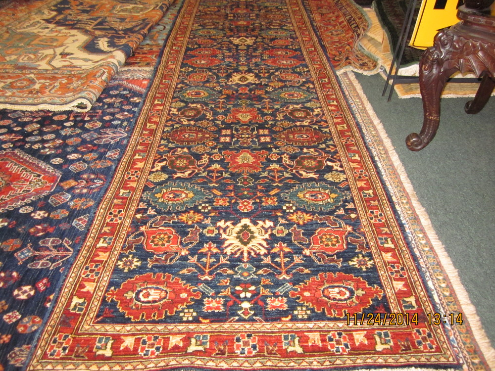 #18)  10 ft. navy Afghan runner in 16th Century Persian design.