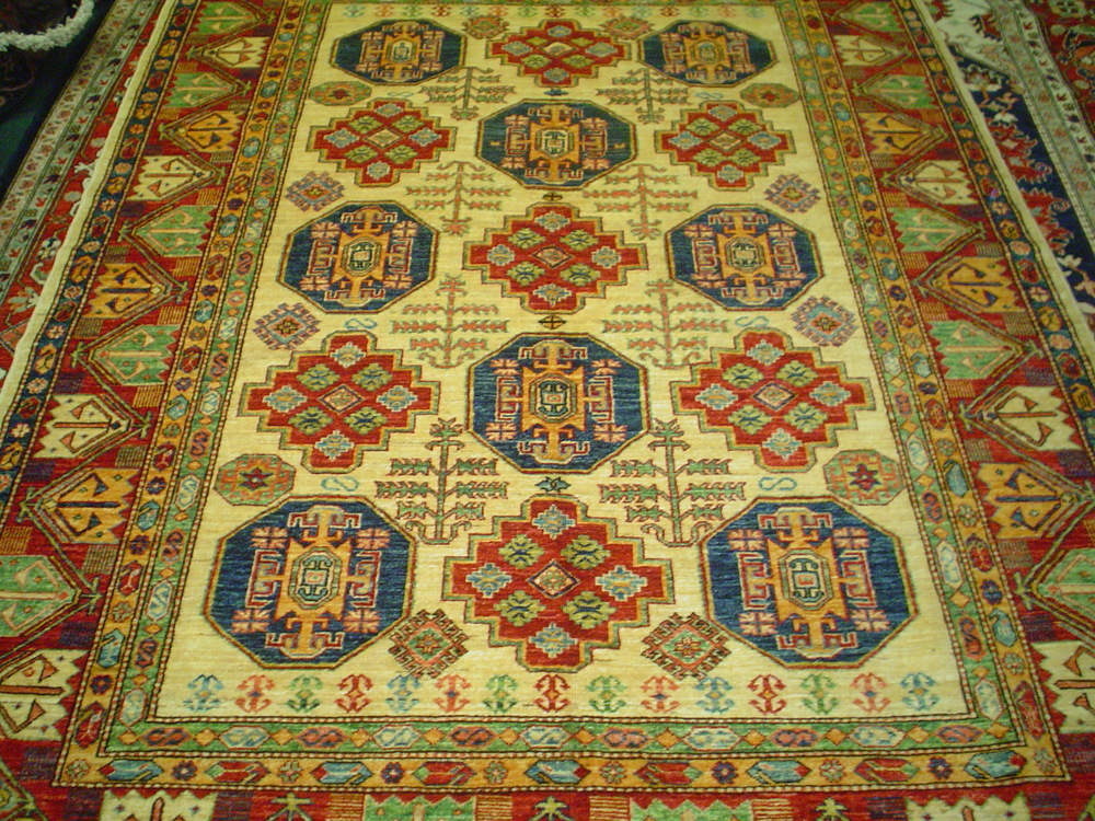 """#19) 6'6"""" x 8'7"""" Ivory Kazak, veg dyes, hand-spun wool. Bright and cheerful rug with warm colors."""