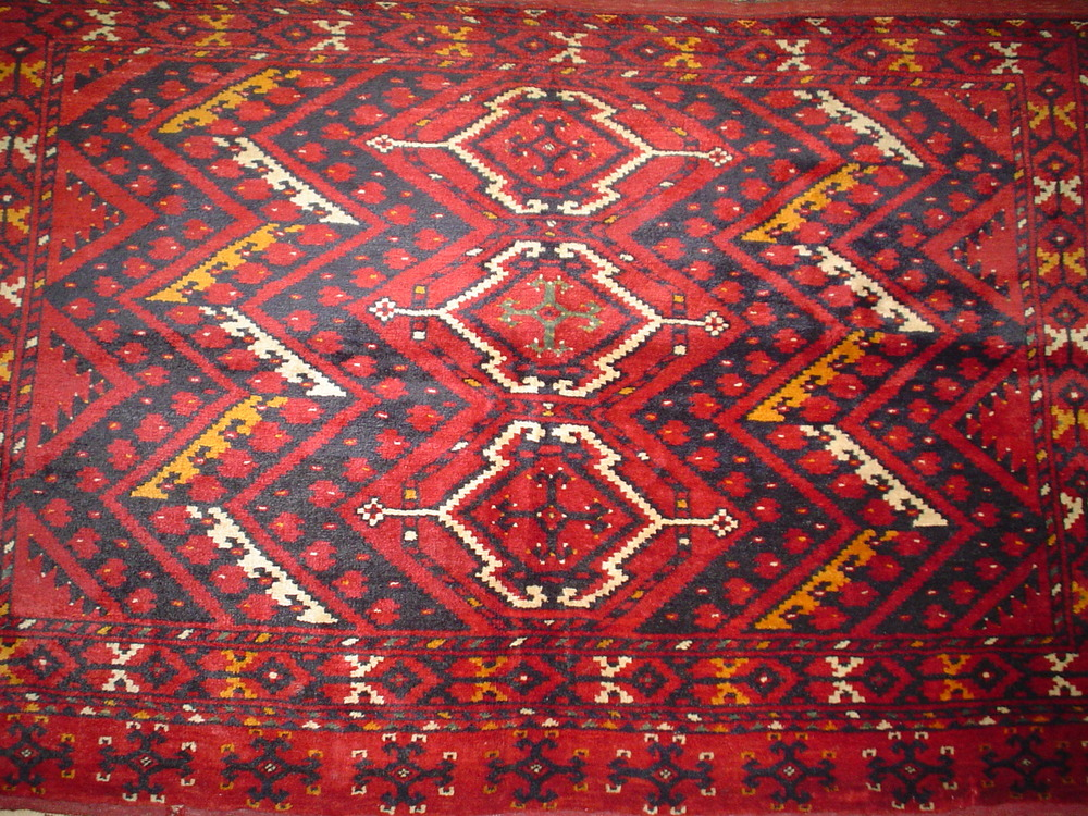 #12)  4 x 6 old Turkoman chuval. Circa 1040's Originally used to cover a large cushion for seating guests.
