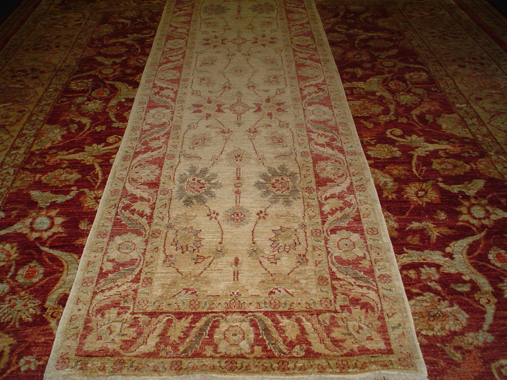 #4) 9 ft. Afghan runner in soft tones.