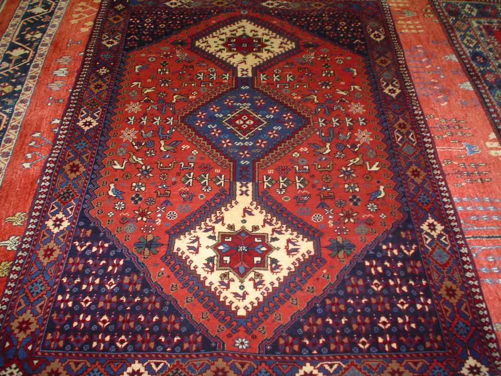#6) 4 x 6 Persian Yalameh rug woven in Southern Iran.