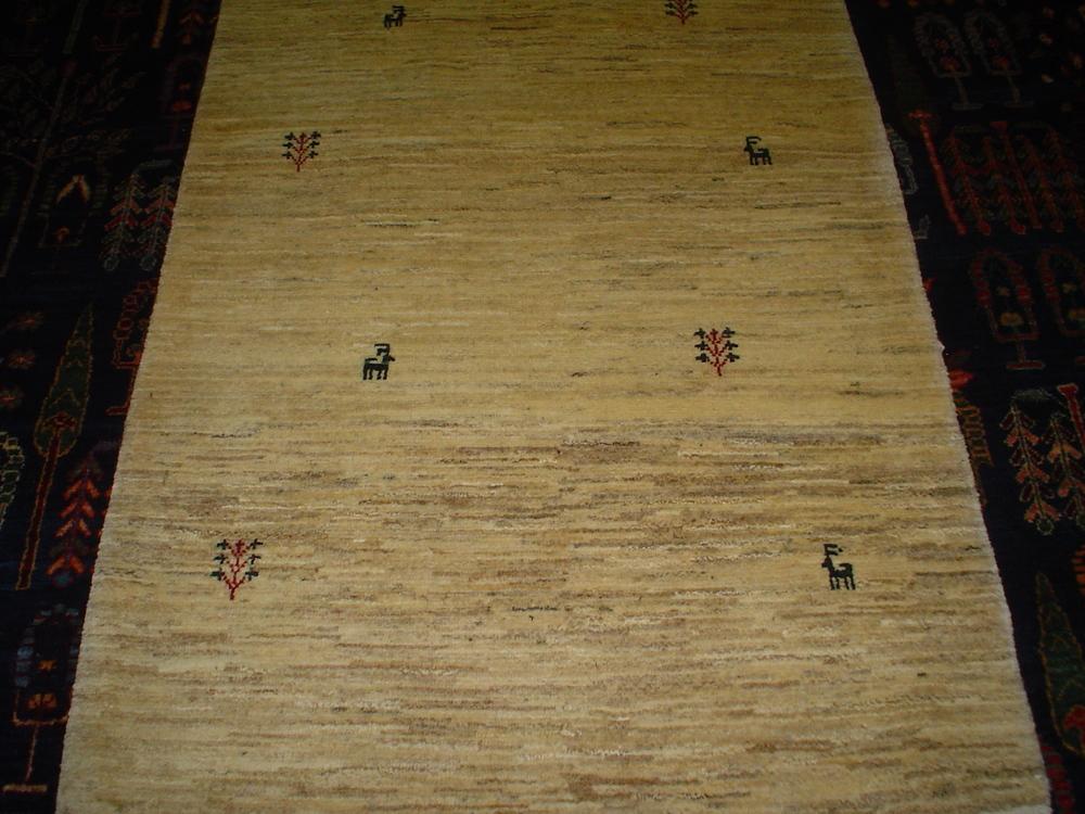#9) Small ivory Gabbeh rug. 2.9 x 4