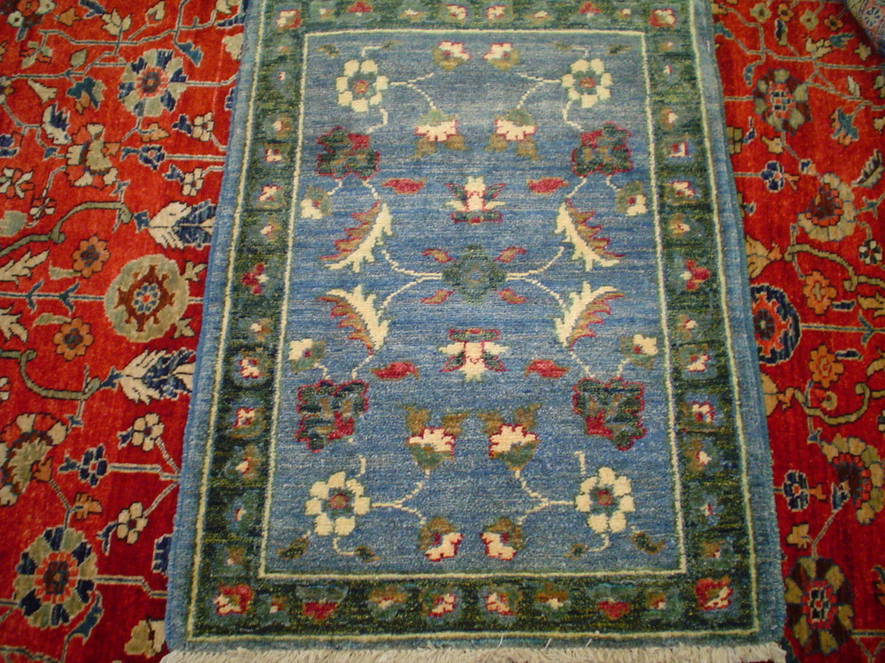 #9) Small rug from Afghanistan. 2 x 3.
