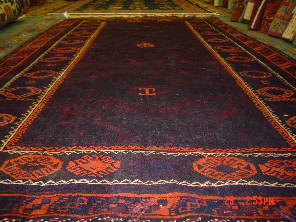 #15) Wonderful 5.4 x 10.5 Old Balouch rug in excellent condition.