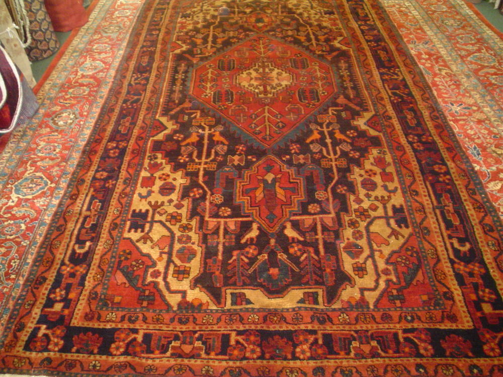 "#14) 5'4"" x 10'2"" Navahand rug from Iran. Woven with lustrous hand spun wool, in rich earth tones."