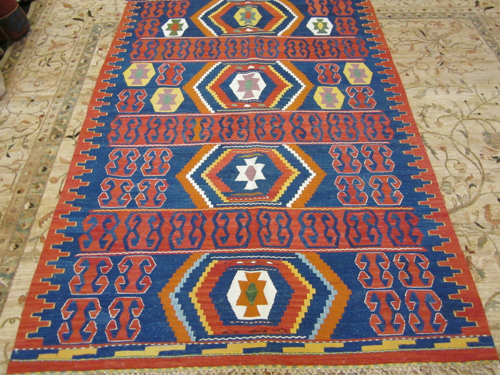 "#18) 4'4"" x 6'5"" Turkish kilim. Bright and cheerful with beautiful knotting on the fringe."