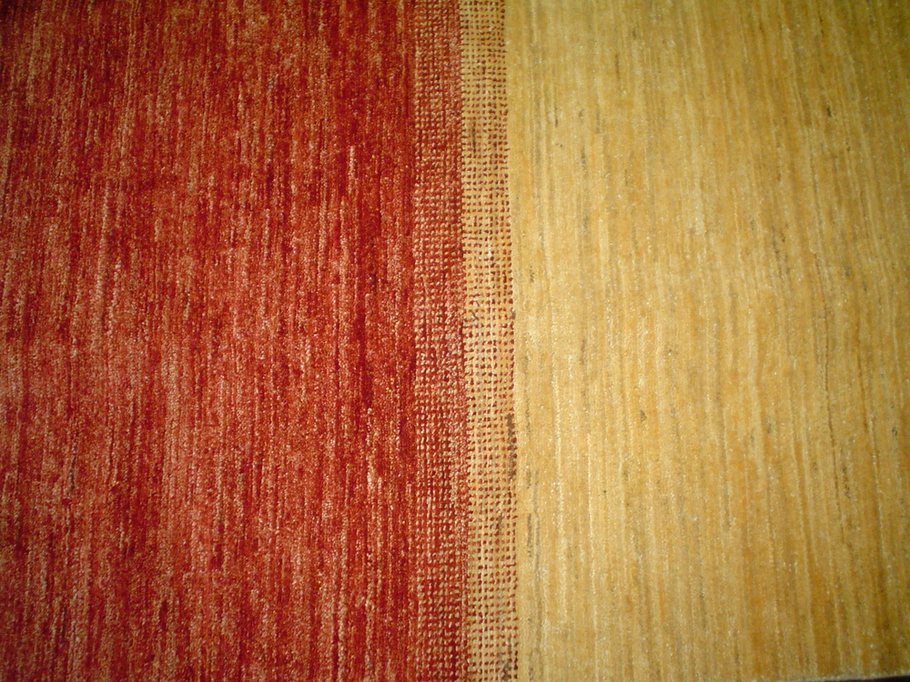 #22) Vegetable dyed wool, in sparkling colors. Colors are one of the most important aspects of an Oriental rug.