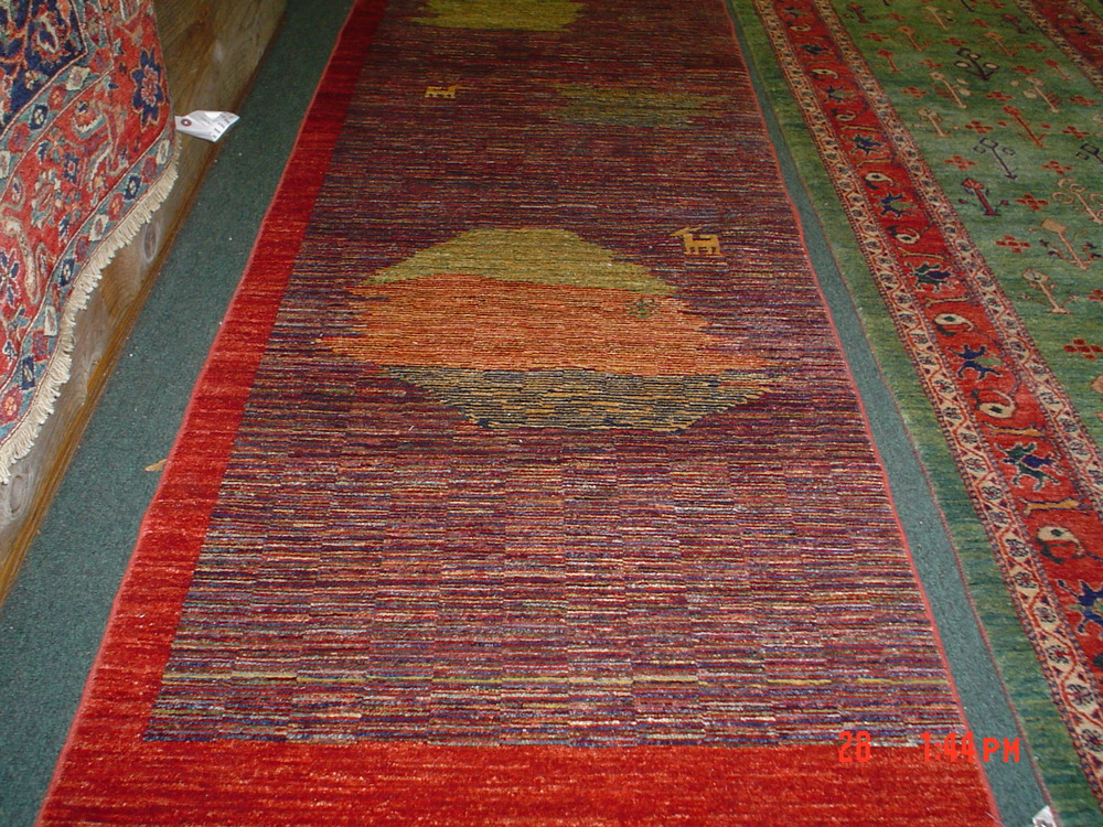 """#17) Smaller modern Afghan runner. 2'6"""" x 8', very finely woven. Multi-colored small runner in a modern design."""