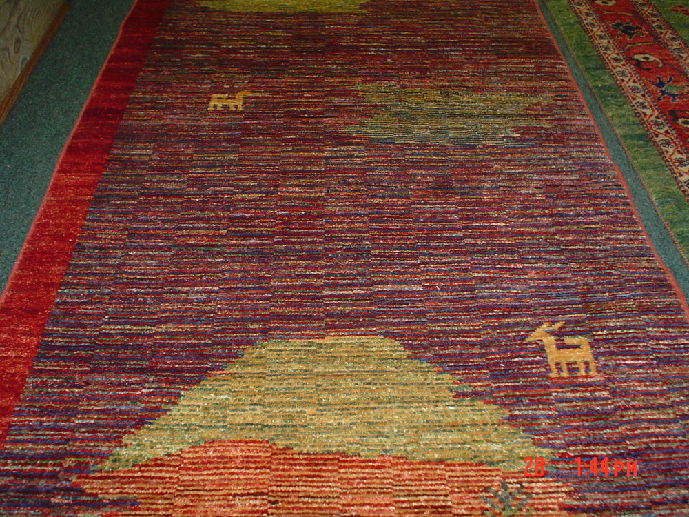"""#25) Modern Afghan runner. 2'6 x 8"""", woven with vegetable dyes and hand spun wool."""