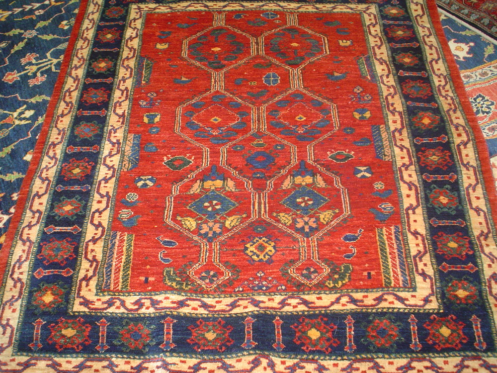 "#26) 4 x 5 Persian tribal rug. Khamsehbaf. Madder red with navy border. 3'11"" x 4'7"""