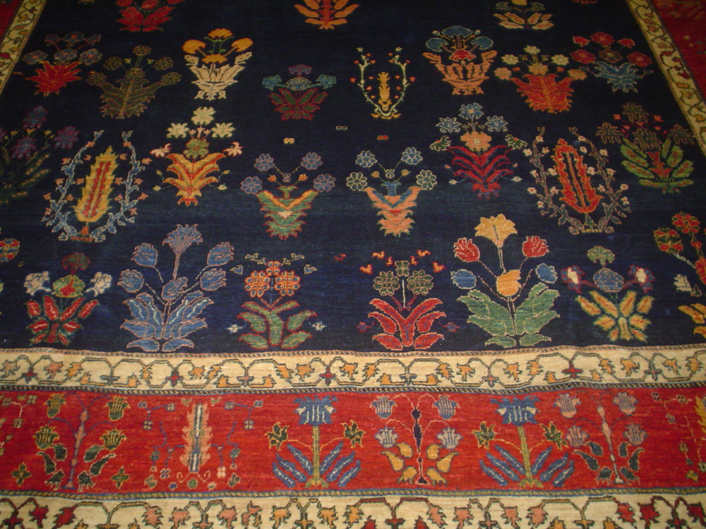 #28) 8 x 11 Persian tribal rug in a beautiful floral design. Close-up.