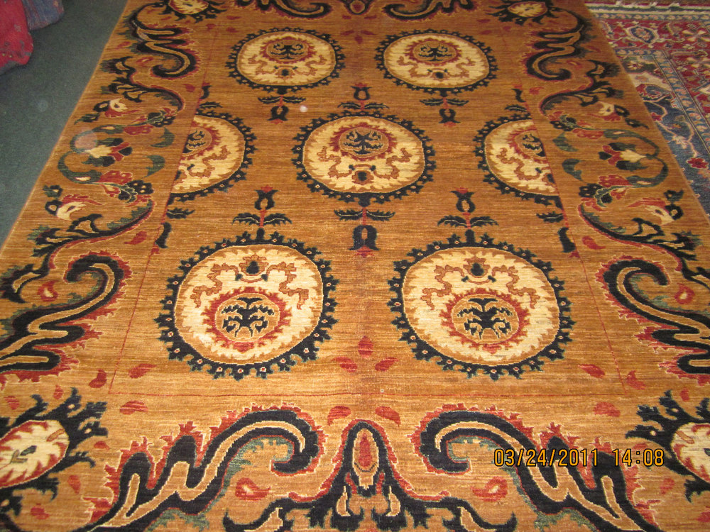 "#24) 6'7"" x 8'3"" New Afghan rug in an old Khotan design."