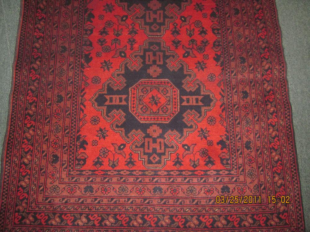 #39) 3 x 5 Afghan rug in a bold tribal design.