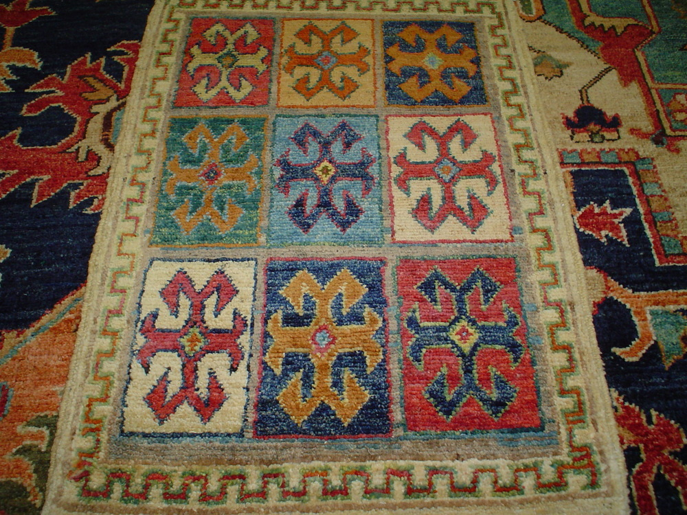 #40) Very small Kazak rug in beautiful colors.