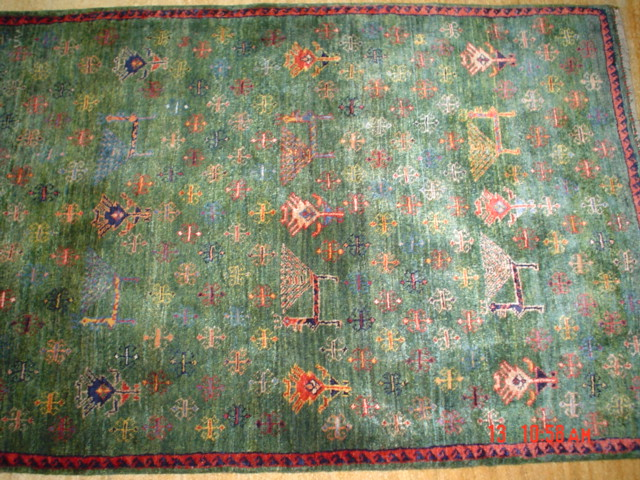 "#1: Unique soft green Persian Lori. 4'2"" x 2'9""."