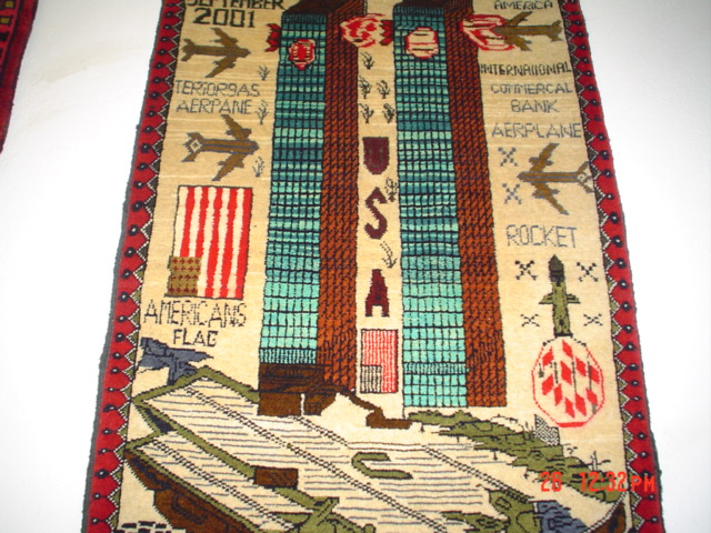 """#9: Afghan War Rug with twin towers and American flag. 2'1"""" x 3' Private collection."""
