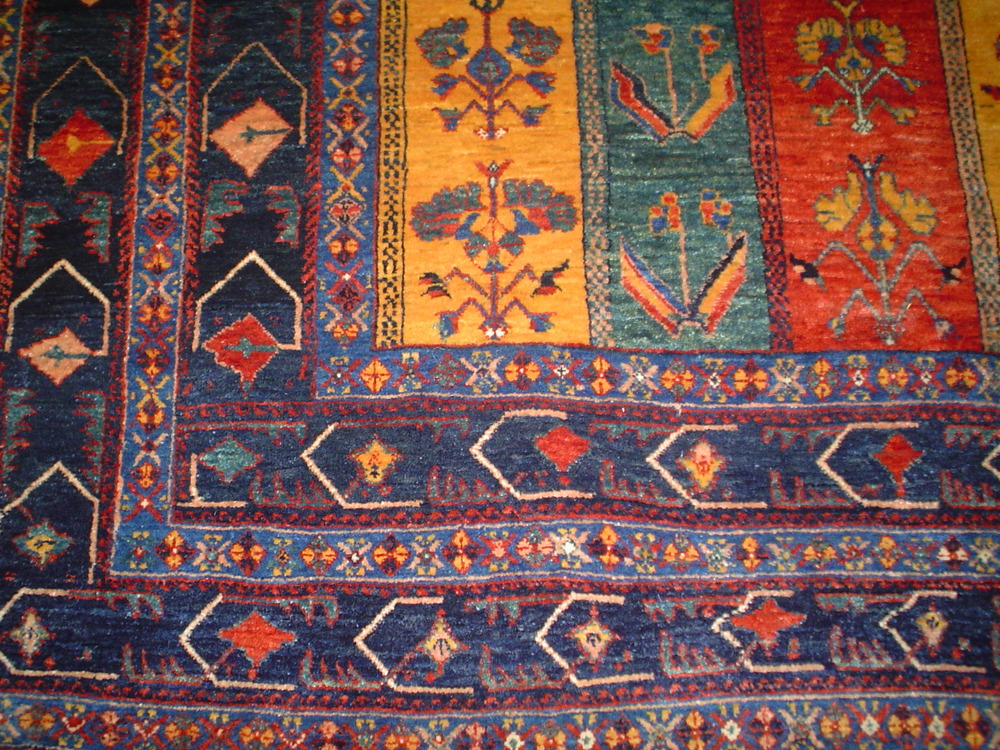 #32: Multicolored Persian tribal rug in jewel tones. Border close-up. New rug in an old tribal design.