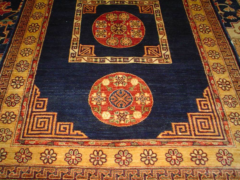 "#18: 5' x 6'5"" Khotan rug in an antique design from East Turkestan. Sold."