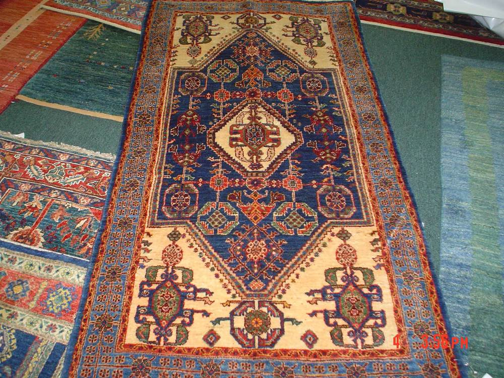 #34: 2.7 x 5 Persian Qashqai runner. Sold. Deep blue, light blue, ivory, red and medium green in a classic Qashqai design.