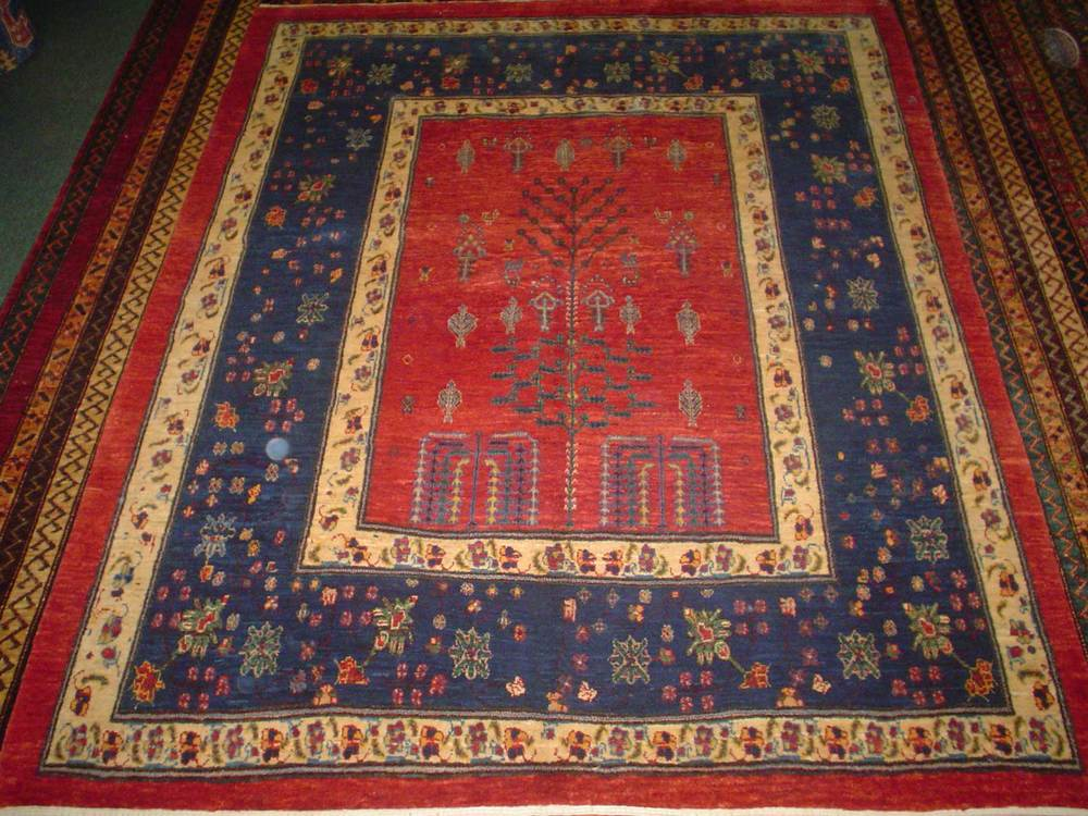 "#44: Beautiful Tree of Life design. Persian Khamsehbaf. The exact size on this rug is 5'1"" x 6'4"". Sold."
