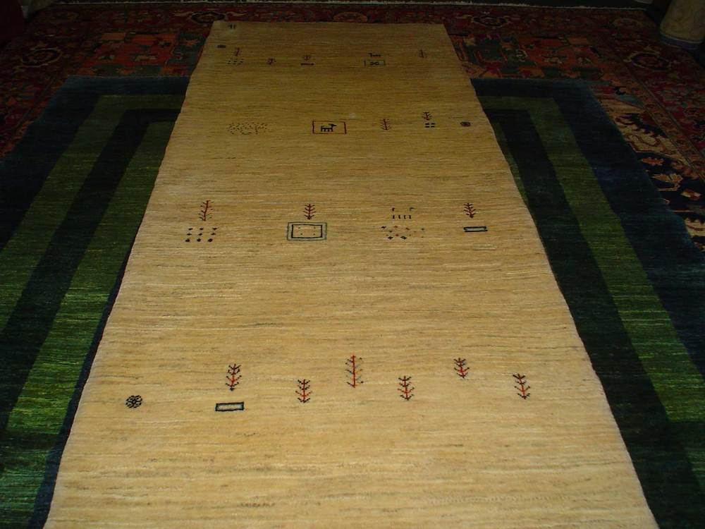 "#45: 3'1"" x 9'8"" Ivory Gabbeh runner. Beautiful piece with charming figures throughout the field. Iran. Sold."
