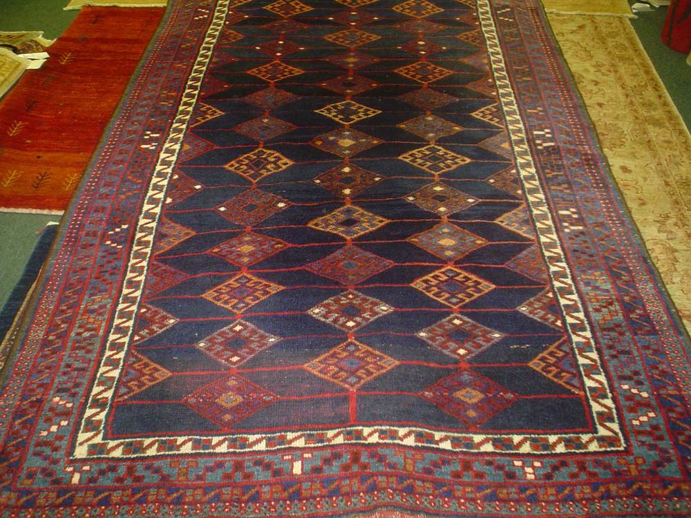 "#6) 5'4"" x 8'6"" Older Kurdish tribal rug. Affordable and hard wearing lovely old Kurdish piece. Navy, gold, light blue and ivory with small increments of deep red."