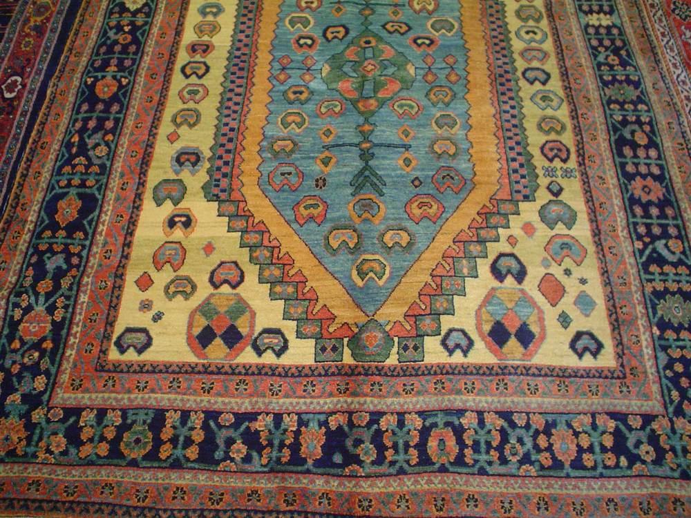 """#10) 5'x 6'8"""" Qashqai rug."""