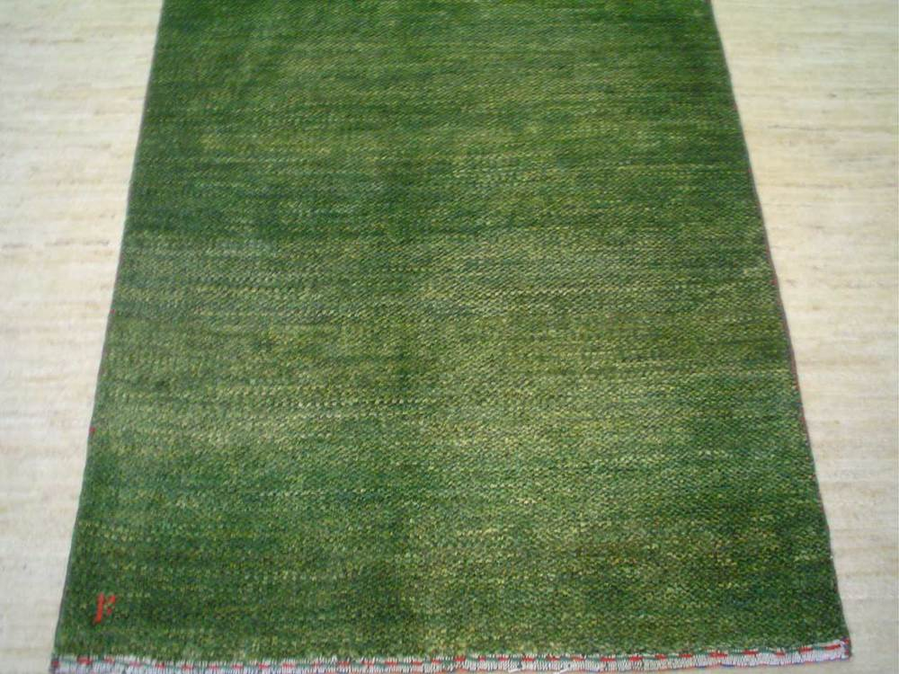 "#20) 2'7"" x 4'1"" light green Persian Gabbeh rug."