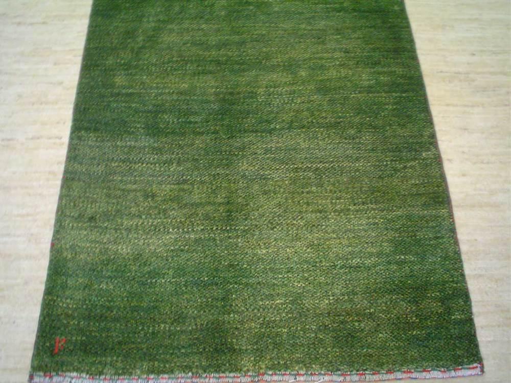 "#20) 2'7"" x 4'1"" light green Persian Gabbeh rug."