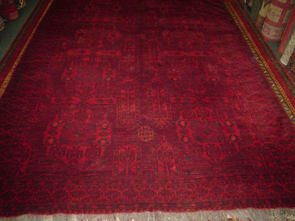 #18) 7' x 10' Semi-antique Turkoman rug. Deep, rich reds, hand spun wool.