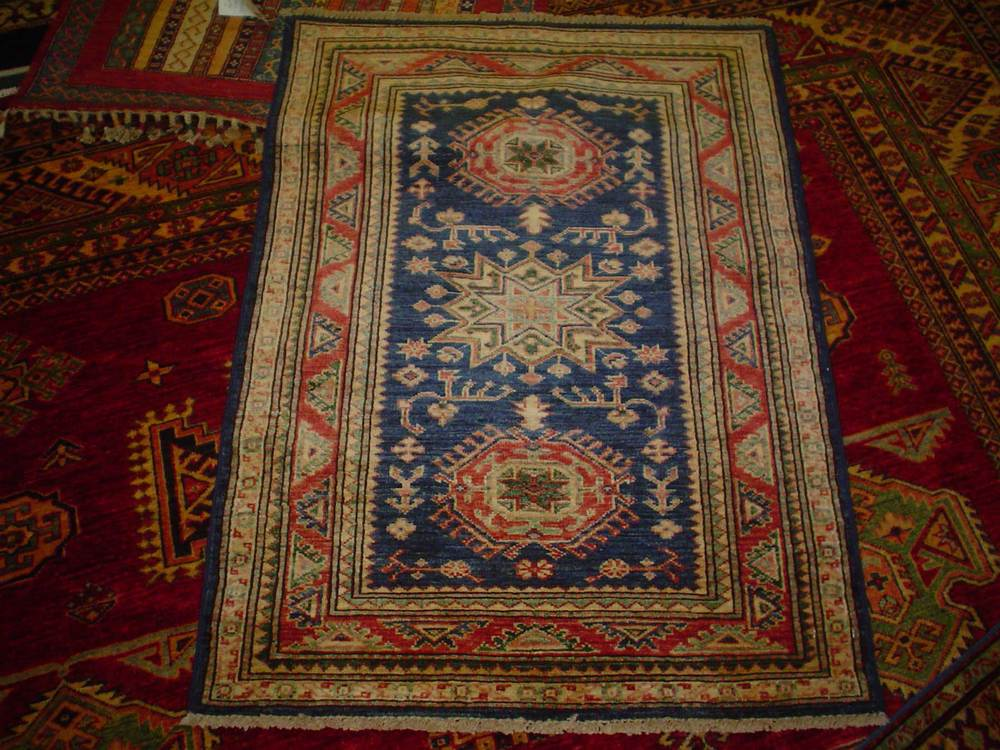 "#19) 2'8"" x 3'7"" Navy Kazak. Cute little rug."