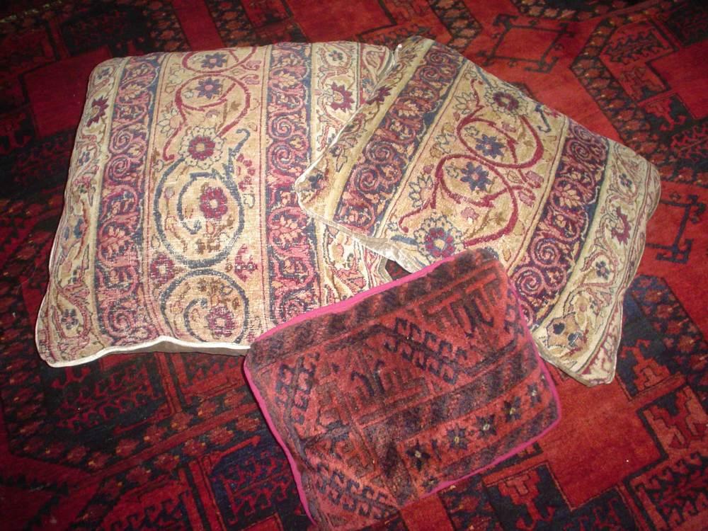 #33) Oriental rug pillows. The two lighter pillows are made from an antique Kerman rug.