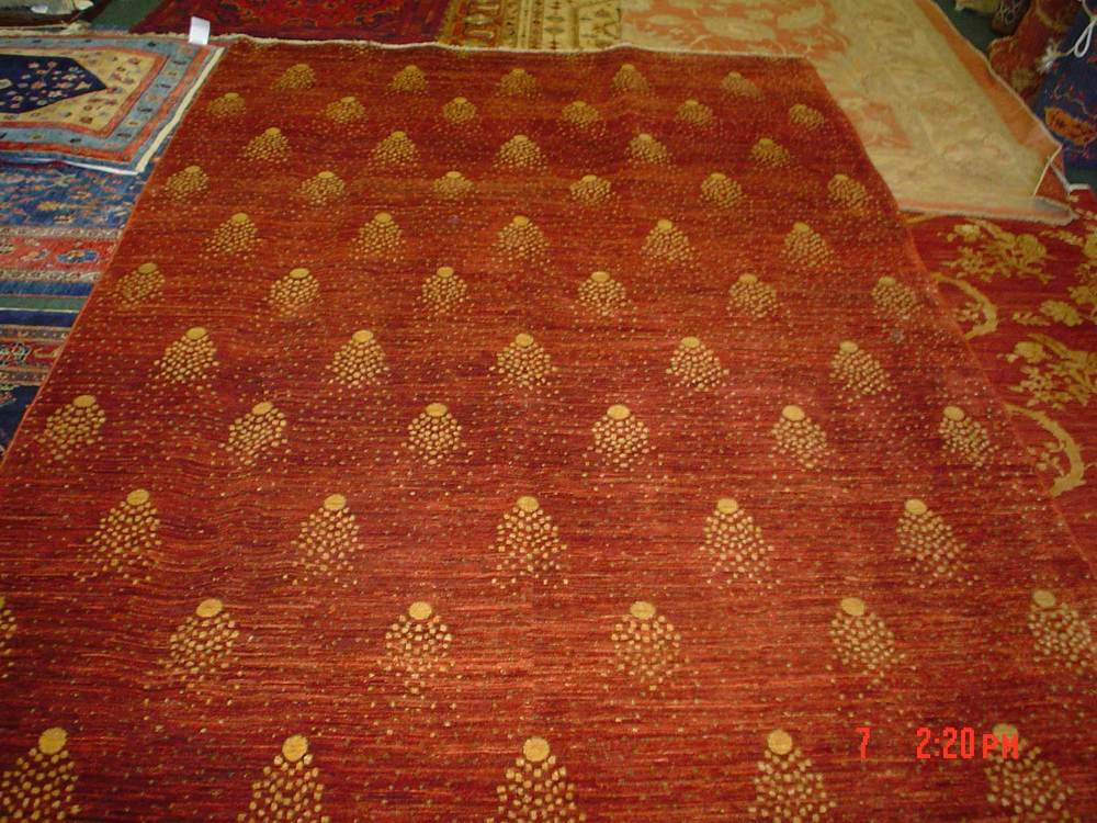 #50: Ariana, shooting stars! Brick red with soft gold accents, finely woven in Afghanistan.