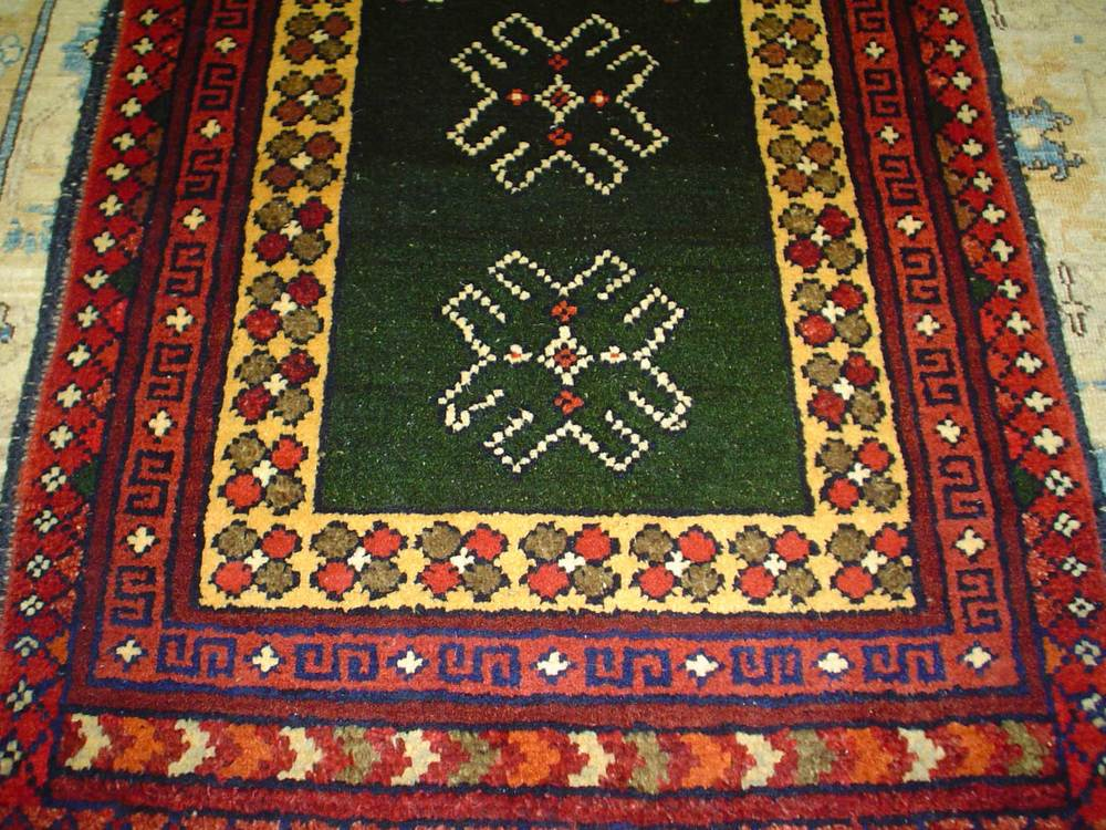 #3) Small 2 x 3 tribal rug. Afghanistan.