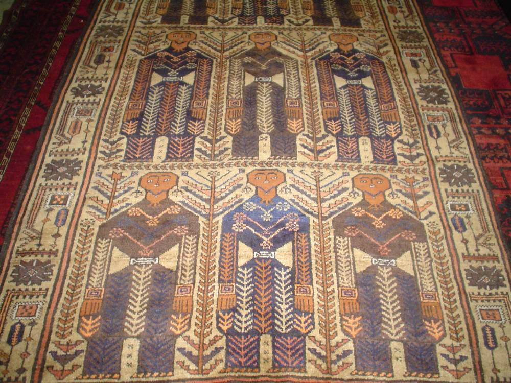 "#5) 4'2"" x 6'11"" Nomadic Balouch rug. Unusual drawing with human figures."