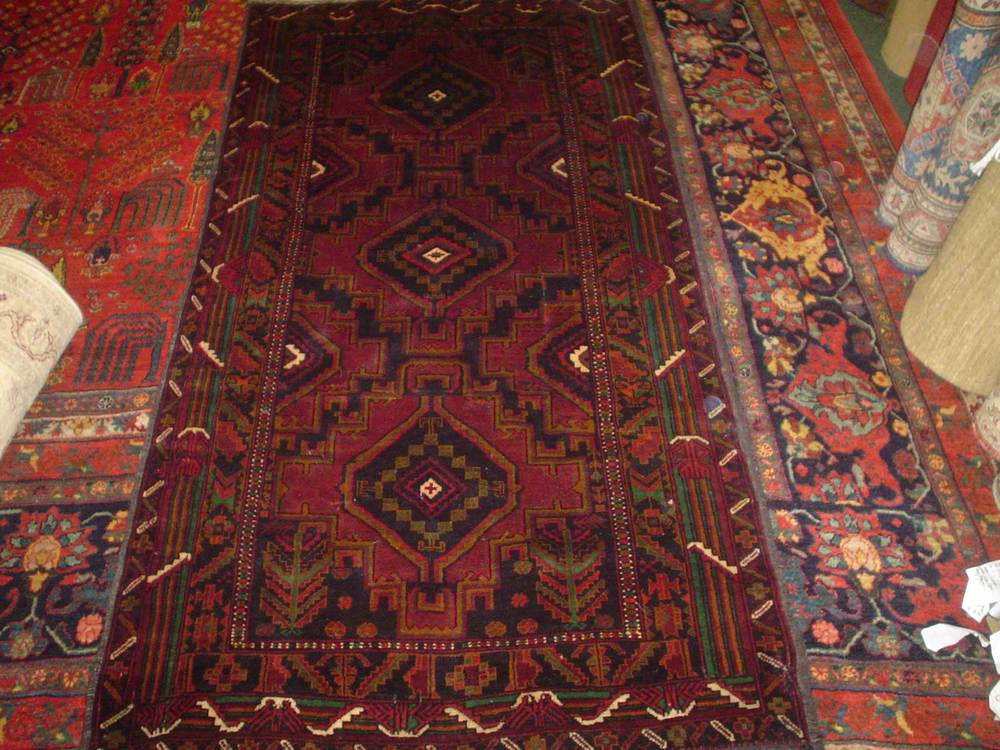 """#14) 3'5"""" x 6'9"""" finely woven Balouch rug."""