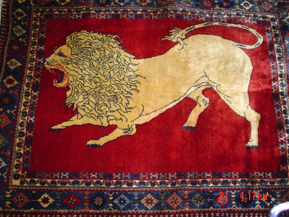 #23) 4 x 5 Persian Yalameh. Lion rug from Southern Iran.