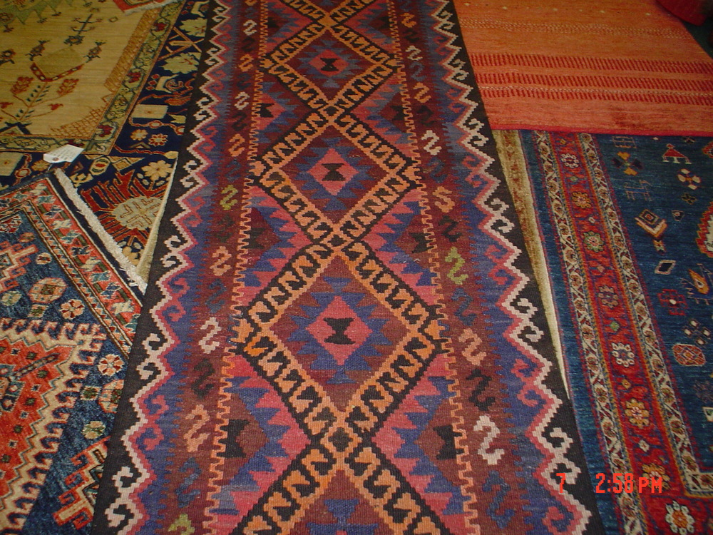 #16) 12 ft. Miamana kilim runner.