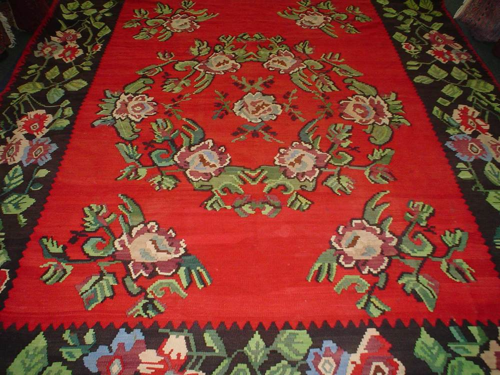 #33) 8' x 11' Romanian Kilim. Lovely true red floral motif with soft greens, blues and rose colors.