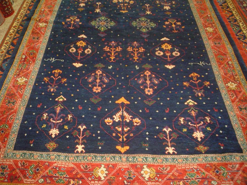 #13: Truly wonderful 6 x 8 Persian tribal rug. Khamsehbaf. Navy with detailed tribal designs and a dark red border.