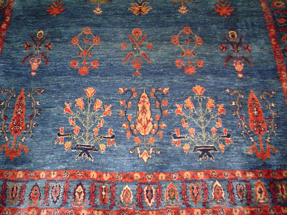 #14: 5 x 7 Qashqai. Woven in Southern Iran. True blue, Persian tribal rug, in a floral design with a red shadow border.