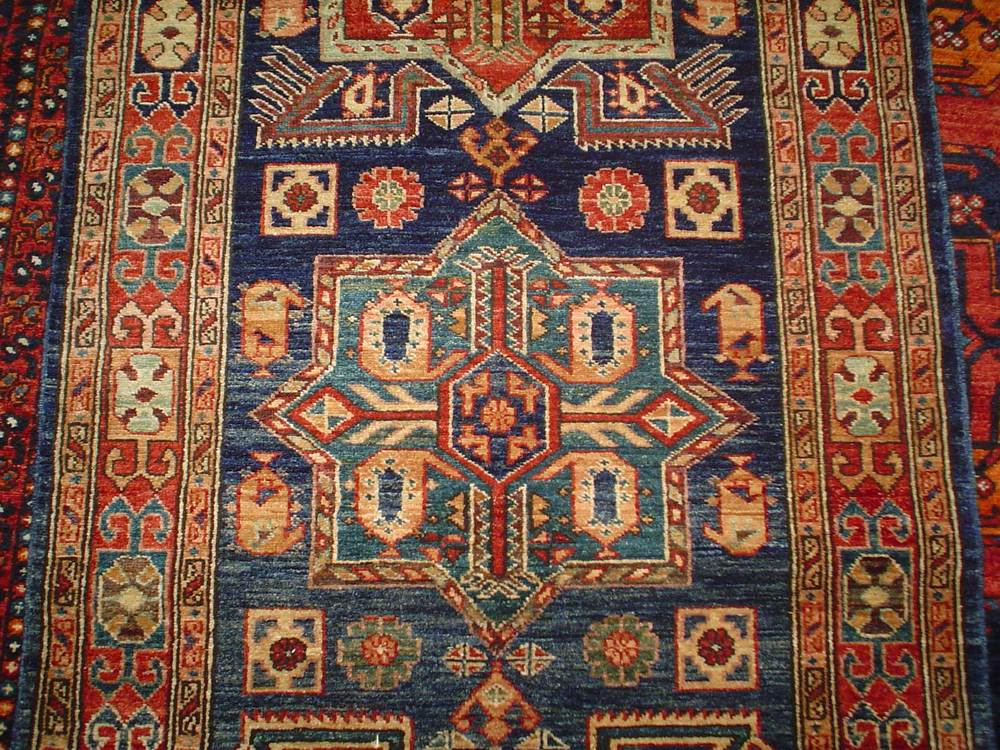 #20: 3 x 12 Kazak runner. Afghanistan. Akstafa Peacock design in navy and red.