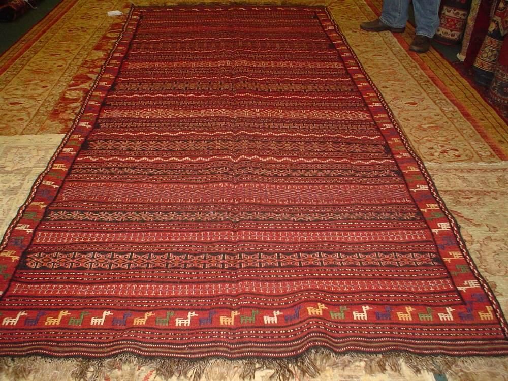 """#13) Kurdish Kilim, 4'10"""" x 10'5"""". Deep red flat woven rug with soumak touches in excellent condition."""