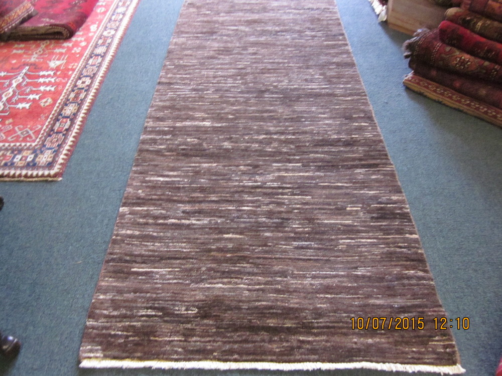#27) 3' x 9'2' Modern Afghan runner in a warm coco brown with ivory.